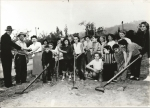 Montecito Heights Audubon Jr. Chapter planting trees at Avenue 43 and Homer Street circa 1954. Sponsor at left shaking h