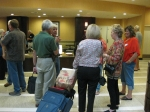 Checking in to Embassy Suites on Friday. Manuel Ruiz explains procedures to group of Phaetons including Norma Wilson, Be