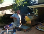Chef Bud Lewallen flipping the burgers