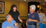 Manuel Rangel, sister Vera (S'61,) and Manuel Ruiz on Friday at Manager's Reception. Sue Lindelef talks to Raeanna Tay