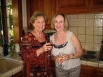 Betty and Norma having a drink in the kitchen