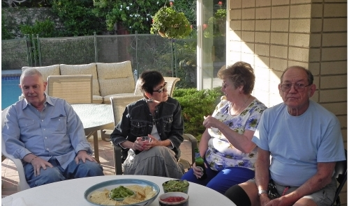 Mitch Mulino on left with wife Syl. Sharon Guthrie to left of friend Don. Norma Wilson's backyard, May 2013