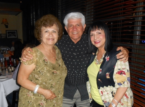 Mercedes Roman, Manny Ruiz, and Patricia Neri out to dinner in 2013